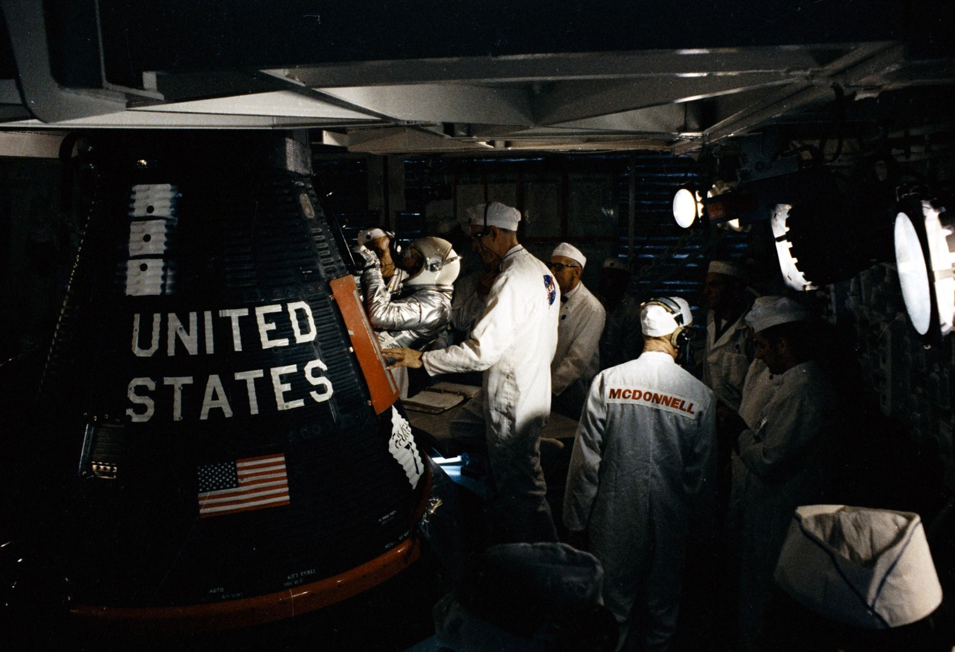 Cooper entering Faith 7 spacecraft before launch