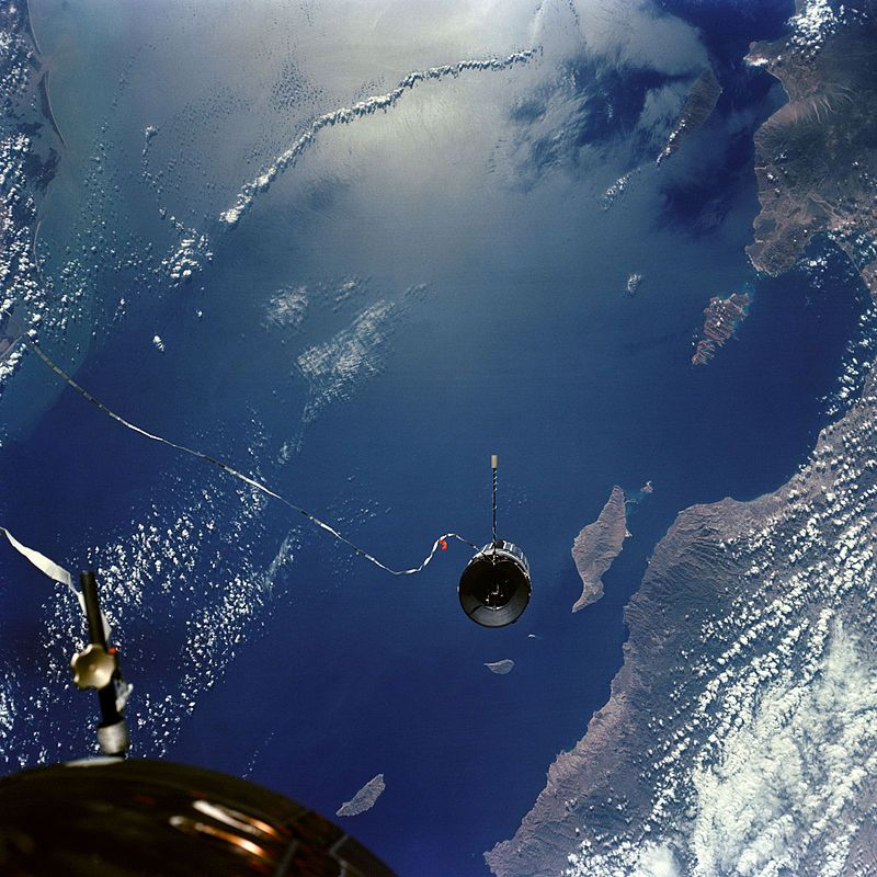 Agena Target Vehicle seen by Gemini 11 backdropped by Earth