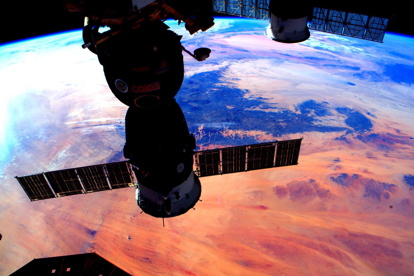 Sunset on Earth behind Soyuz spacecraft docked at ISS
